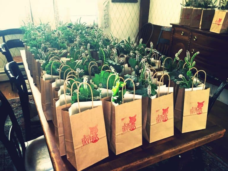 bags with plants insdie with the fox tavern logo stamped